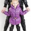 Mother and daughter wearing jackets and black boots — Stock Photo