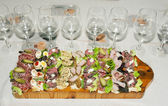 Sandwiches with wineglasses — Stock Photo