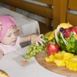 Portrait of little girl with fruit — Stock Photo