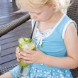 Portrait of little girl with a glass of cocktail — Stock Photo #18516731