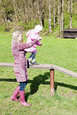 Mother with her daughter at playground — Stock Photo