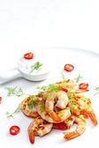 Grilled prawns with dip of garlic, chilli and dill — Stock Photo