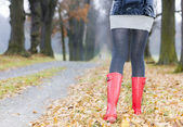 Detail of woman wearing rubber boots — Stock Photo