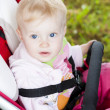 Portrait of toddler sitting in a pram - Stock Photo