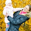 Royalty-Free Stock Photo: Portrait of woman with toddler in autumnal nature