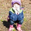 Little girl wearing rubber boots with snowflakes in spring natur - Foto Stock