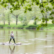 Royalty-Free Stock Photo: Woman fishing in Sazava river, Czech Republic