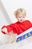 Little girl painting with watercolors — Stockfoto
