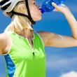 Portrait of biker with bottle of water — Stock Photo #19989205