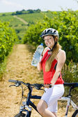 Biker with bottle of water — Stock Photo