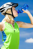 Portrait of biker with bottle of water — Stock Photo