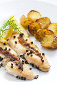 Butterfish baked on pepper and anchovies — Stock Photo