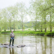Woman fishing in Sazava river, Czech Republic — ストック写真