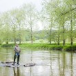 Woman fishing in Sazava river, Czech Republic — 图库照片
