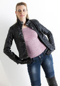 Portrait of standing woman wearing jeans — Stock Photo