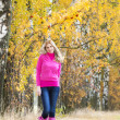 Woman wearing rubber boots in autumnal nature — Stok fotoğraf