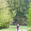 Woman wearing rubber boots in spring nature — Stock Photo