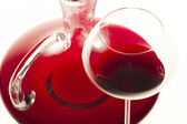 Wine glass and carafe with red wine — Stock Photo