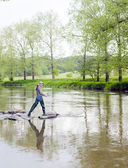 Woman fishing in Sazava river, Czech Republic — Stock fotografie