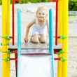 Little girl at playground — Stock Photo #23607781