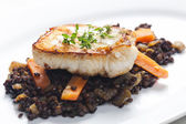 Pikeperch fillet with lentils and carrot — Stock Photo