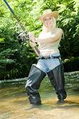 Woman fishing in river — Stock Photo