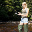 Woman fishing in Jizera river, Czech Republic — Stock Photo