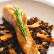Salmon fillet with lentils and carrot - Stock Photo