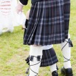 Stock Photo: Detail of mand child wearing kilt, Scotland