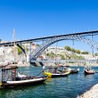Stock Photo: Dom Luis I Bridge and typical boats (rabelos), Porto, Portugal