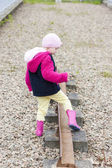 Little girl at out of action track on Laigh Milton Viaduct, East — Stock Photo