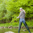 Woman fishing in Sazava river, Czech Republic — Stockfoto
