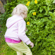 Little girl wearing rubber boots in garden — Photo