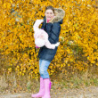 Mother with her daughter in autumnal nature — Stock Photo #27363893