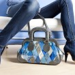 Stock Photo: Detail of womwearing blue shoes and with handbag