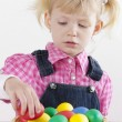 Portrait of little girl with Easter eggs — Stock Photo #27364881