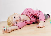 Portrait of lying little girl — Foto Stock