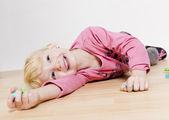 Portrait of lying little girl — Stock Photo