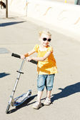 Little girl with a scooter — Stock Photo