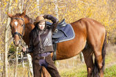 Equestrian with her horse in autumnal nature — Stok fotoğraf