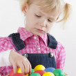 Portrait of little girl with Easter eggs — Stock Photo