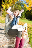 Mother with her little daughter in autumnal nature — Stock Photo