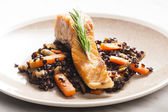 Salmon fillet with lentils and carrot — Stock Photo