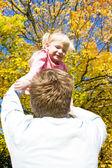 Father with her little daughter in autumnal nature — Stock Photo