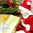 Little girl as Santa Claus with Christmas presents — Stock Photo