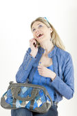 Portrait of sitting woman with mobile phone and handbag — Стоковое фото