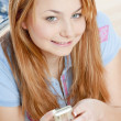 Portrait of woman with mobile phone — Stock Photo
