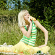 Woman with a baguette at a picnic — Stock Photo #32071011
