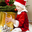 Little girl as Santa Claus with Christmas presents — Foto de Stock