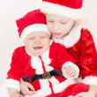 Two little girls as Santa Clauses — Stock Photo #32075541